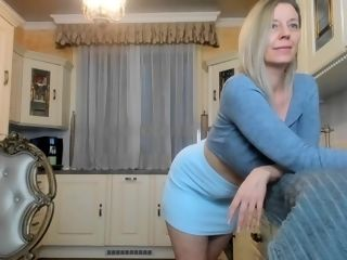 Blond mature striptease in the kitchen