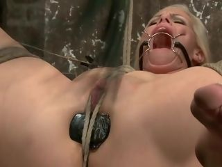 Ash-blonde tramp is ball-gagged and lashed hog-tie