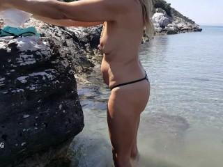 Nipringlover topless in shallow waters at public beach demonstrating big gauge nip piercings