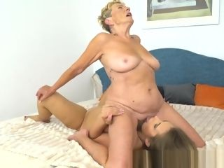 Big-titted grannie Dyke pleasuring youthful cutie
