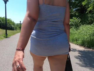 Wifey chilling in park with sundress demonstrating thong and cameltoe