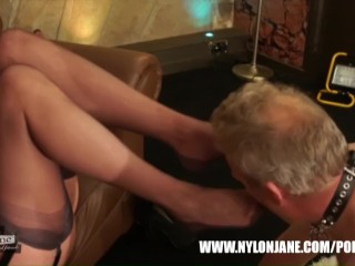 Cougar Nylon Jane taunts man with nylon caked soles pawing his face penis