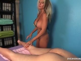 This mature doll gives him a hand-job!