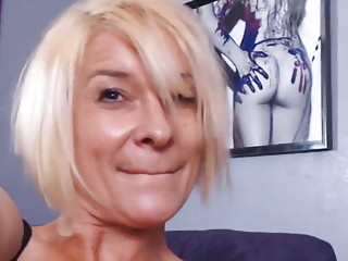 Milf manhandles adult toys while alone at home