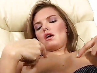 Czech undergarments model is wearing ebony stockings while playing with a fresh fake penis and liking it
