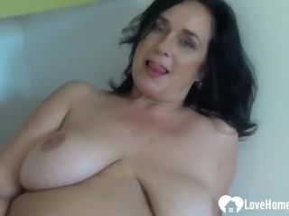 'Amateur dame with enormous udders thumbs herself'