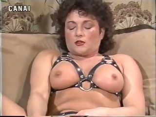 Huge-chested old-school dark haired mummy on the armchair draining