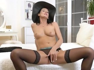 Uber-sexy doll is wearing stockings while stretching her gams wide to display her bald vulva