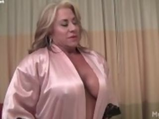 """Blonde mature muscle maven showcase her meaty clit"""