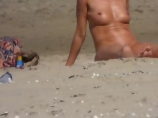 Mature cougar nude on the beach