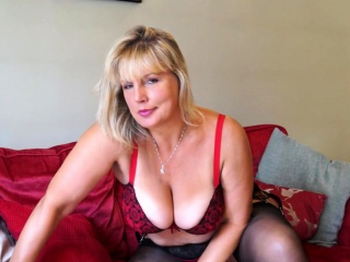 Mischievous housewife displaying off her immense jugs