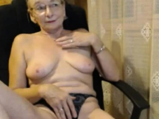 Mischievous mature stripteasing and seducing