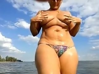 My jiggish housewife is glad to tease her clittie right in the sea