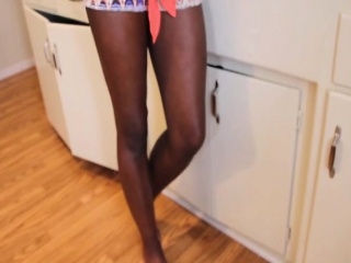 Dark-hued housewife masturbating pecker in kitchen