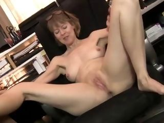 Slender, mature with innate mounds is opening up up wide while jerking in front of the camera