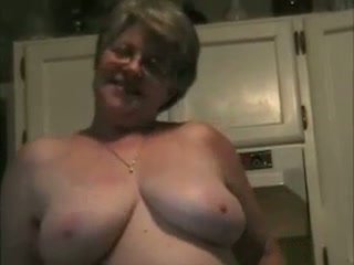 Obscene plus-size mommy disrobing invitingly in a kitchen