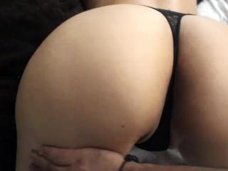 Her fleshy caboose in dark-hued thong