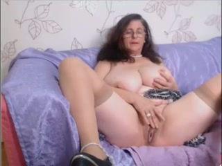 Pallid skinned grandmother demonstrating her bumpers and rump on cam