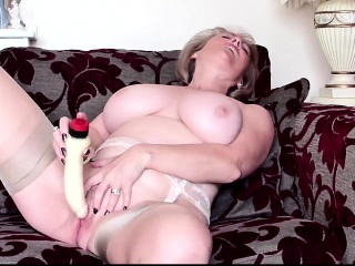 Elderly and naughty grannie using a fake penis to jack