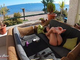 Lady strokes In Public On A Balcony